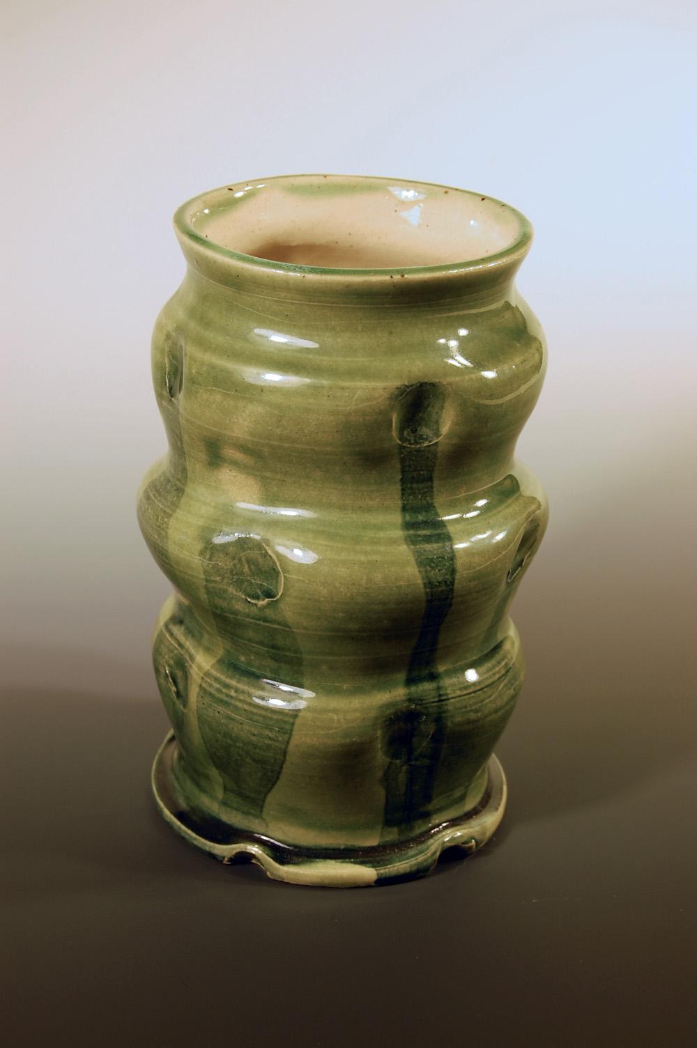Green undulating vase