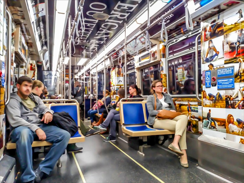 Commuters in a Chicago subway car at the end of the day.
